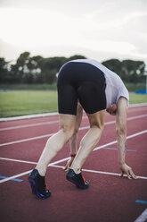 Runner on tartan track in starting position - ACPF00357