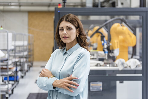 Portrait of a businesswoman, working in a manufacturing company - DIGF05160
