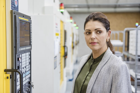 Businesswoman working in a high tech company, portrait - DIGF05214
