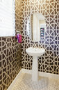 Bathroom sink and mirror with patterned wallpaper - LUXF01385