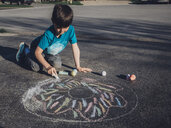 Boy drawing with chalk on asphalt - CAVF50124