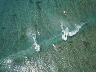Aerial view of people surfing on sea at Maldives during sunny day - CAVF50166
