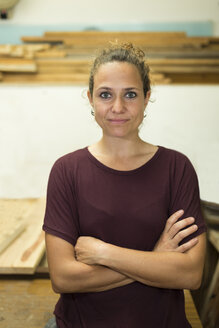 Portrait of confident craftswoman in her workshop - JPTF00044