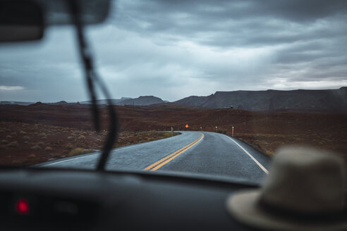 USA, Utah, Car driving to Monument Valley under a stormy sky - KKAF02547