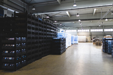 Crates of water bottles in warehouse - CAVF50510