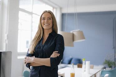 Portrait of smiling young businesswoman in office - KNSF05009