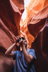 USA, Arizona, Lower Antelope Canyon, tourist photographing - KKAF02556