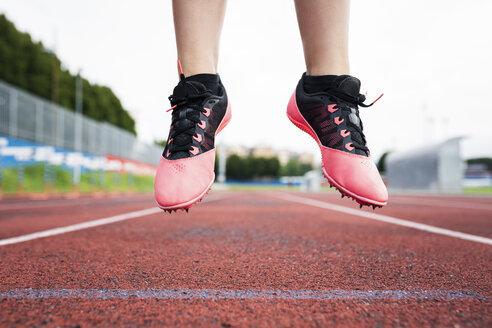 Feet of a jumping runner, mid air - GIOF04793