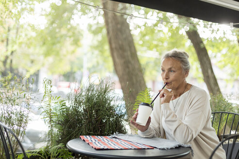 Senior woman with a drink at an outdoor cafe - VGF00049