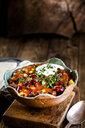 Chili con carne with kidney beans and corn, sour cream, parsley, tortilla bread - SBDF03781