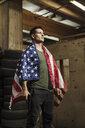 Man wearing American flag holding a gun - KKAF02609