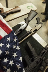Rifles and American flag on table - KKAF02615