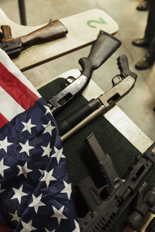 Rifles and American flag on table - KKAF02615