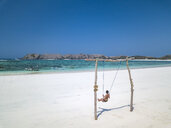 Indonesia, Lombok, young woman on a swing - KNTF02228