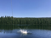 Scenic view of Rucker Lake against clear blue sky during sunny day - CAVF50782