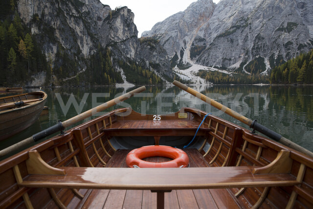 Cropped image of boat moored on calm lake by mountain - CAVF50794