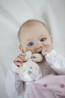 Portrait of baby girl with toy bunny - JLOF00237