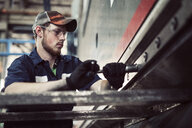 Low angle view of man working in steel industry - CAVF51313