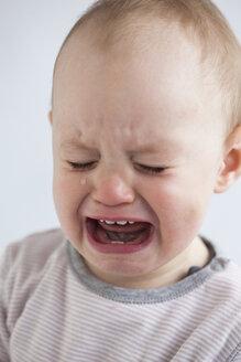 Portrait of crying baby girl - JLOF00282
