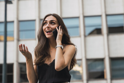 Portrait of smiling young woman on the phone - KKAF02826