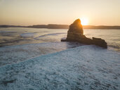 Indonesia, Lombok, Aerial view of rock formation near Kuta at sunset - KNTF02262