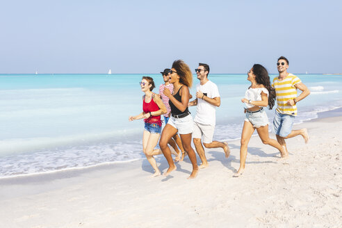 Friends having fun, running on the beach - WPEF00966