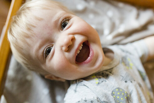 Close-up portrait of happy baby boy at home - CAVF51364