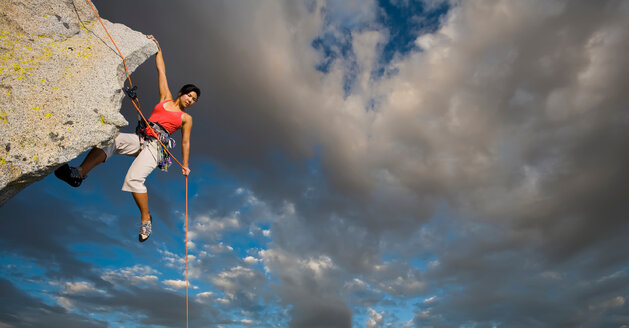 Climber holding on a rope. Beautiful mountain landscape - INGF03501