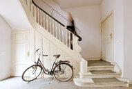 Bicycle sits against stairs in a building - INGF03639