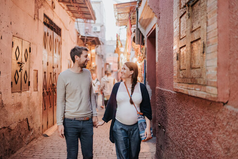 Pregnant couple on vacation, Marrakech, Morocco - CUF46326