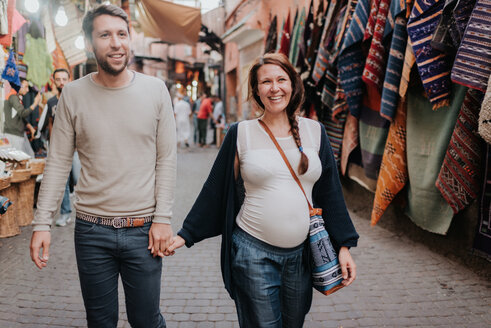 Pregnant couple on vacation, Marrakech, Morocco - CUF46329