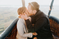 Newly engaged couple in hot air balloon - CUF46335