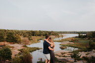Couple enjoying view of river, Algonquin Park, Canada - CUF46356