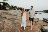 Couple walking in Algonquin Park, Canada - CUF46362