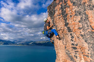 Man rock climbing, Narsaq, Vestgronland, South Greenland - CUF46440