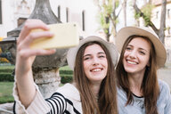 Girlfriends taking selfie at piazza, Belluno, Veneto, Italy - CUF46464