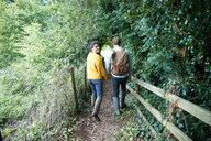 Hiker couple walking in countryside - CUF46530