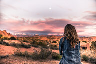 Woman looking at sunset in the desert, Moab, Utah - ISF20022