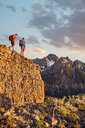 Hikers on mountain peak, Mount Sneffels, Ouray, Colorado, USA - ISF20094