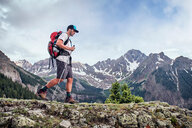 Man hiking, Mount Sneffels, Ouray, Colorado, USA - ISF20100