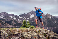 Man hiking, Mount Sneffels, Ouray, Colorado, USA - ISF20106