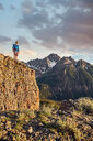 Hiker on mountain peak, Mount Sneffels, Ouray, Colorado, USA - ISF20112