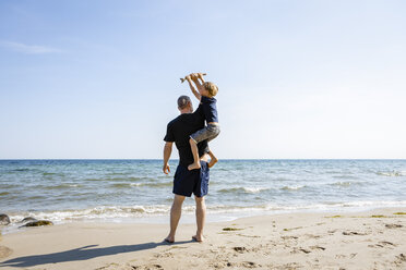 Father and son playing at the beach - OJF00288