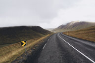 Empty road amidst mountains against cloudy sky - CAVF51460
