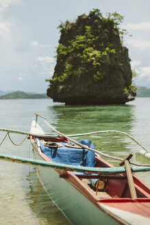Boat moored in sea against rock formation - CAVF51640