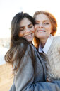 Portrait of mother touching cheek with daughter at beach - CAVF52204