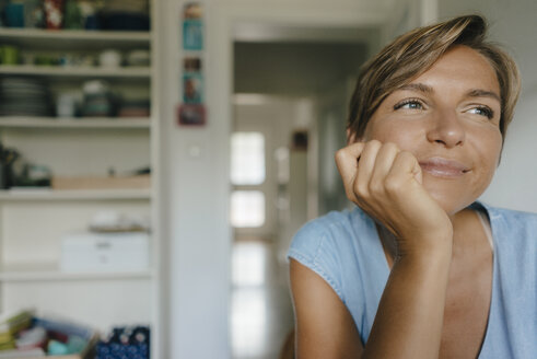 Portrait of smiling woman at home - KNSF05047