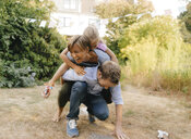 Happy carefree family in garden - KNSF05107