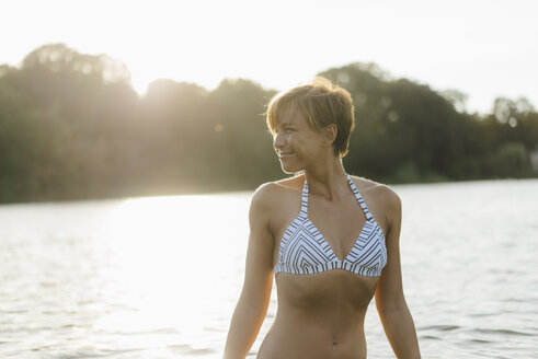 Portrait of woman wearing a bikini in a lake - KNSF05152