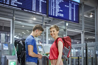 Couple passing security gate at the airport - RHF02239